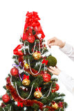 Decorating christmas tree. With balls, ribbons and stuff, isolated on white background Royalty Free Stock Photography