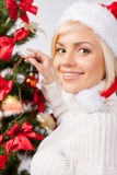 Decorating a Christmas tree. Stock Photo