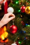 Decorating Christmas Tree. Royalty Free Stock Photography