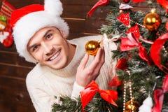 Decorating Christmas Tree. Stock Photo