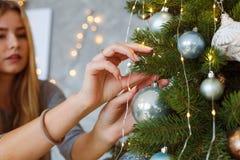 Decorating Christmas tree on Christmas Eve stock images
