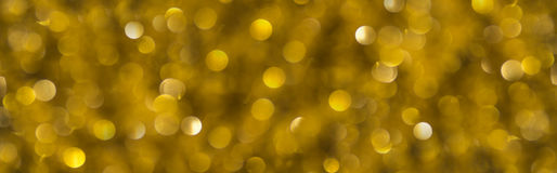 Decorating the Christmas tree on the gold. Gold background in the form of lights Stock Photos