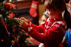 Decorating Christmas tree Stock Photo
