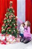 Decorating the Christmas tree Royalty Free Stock Photo