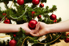 People Decorating For Christmas decorating the christmas tree stock photo - image: 34588420