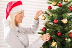 Decorating Christmas tree Royalty Free Stock Image