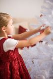 Decorating a christmastree Royalty Free Stock Image