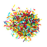 Decorating colored sugar jimmies Stock Images