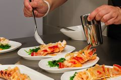 Decorating cooked lobster on plate Royalty Free Stock Photos