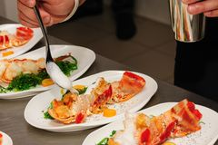 Decorating cooked lobster on plate Royalty Free Stock Photography