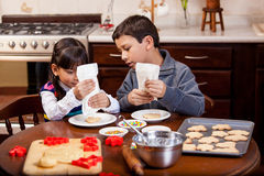 Decorating cookies in the kitchen Royalty Free Stock Images