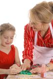 Decorating cookies together Royalty Free Stock Photo