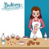 Decorating a cupcake Royalty Free Stock Image