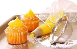 Decorating cupcakes Stock Photos