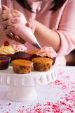 Decorating cupcakes Royalty Free Stock Photo