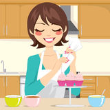 Decorating Cupcakes in Kitchen Royalty Free Stock Photo