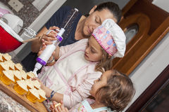 Decorating cupcakes with mom Stock Photo
