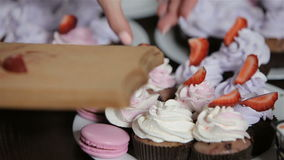 Decorating cupcakes. Two young women are making cupcakes stock video