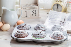 Decorating delicious cupcakes with caster sugar Stock Photo