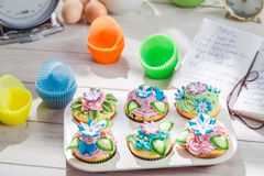 Decorating delicious cupcakes with cream Royalty Free Stock Photography