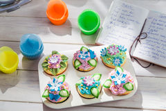 Decorating delicious cupcakes with sweet cream Royalty Free Stock Images
