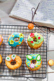 Decorating delicious donuts in the rustic kitchen Royalty Free Stock Image