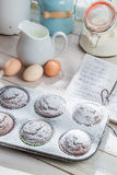 Decorating delicious muffins with caster sugar Royalty Free Stock Photography