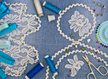 Decorating denim lace and ribbons. Stock Photo
