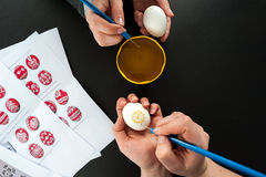 Decorating an Easter eggs Royalty Free Stock Image