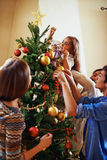 Decorating firtree together Stock Photography