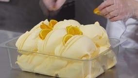 Decorating fruit ice cream by orange slices stock video footage