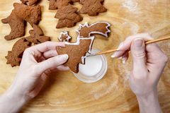 Decorating gingerbread cookies for christmas Stock Photos