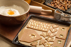 Decorating gingerbread cookies nuts Stock Images