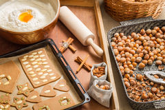 Decorating gingerbread cookies nuts just before baking Royalty Free Stock Image