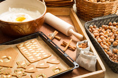 Decorating gingerbread cookies nuts just before baking Royalty Free Stock Images