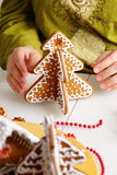 Decorating gingerbread cookies. Royalty Free Stock Photo