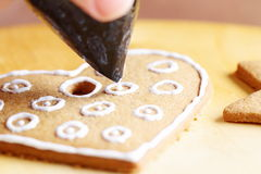 Decorating gingerbread cookies. Stock Images