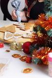 Decorating gingerbread cookies. Stock Photography