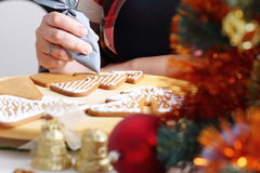 Decorating gingerbread cookies. Royalty Free Stock Image