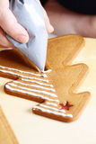 Decorating gingerbread cookies. Stock Photo