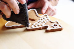 Decorating gingerbread cookies. Royalty Free Stock Photos