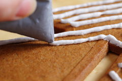 Decorating gingerbread cookies. Royalty Free Stock Photography