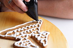 Decorating gingerbread cookies. Stock Image