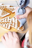 Decorating gingerbread cookies. Royalty Free Stock Images