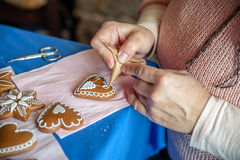 Decorating a gingerbread heart Stock Image