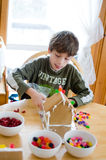 Decorating gingerbread houses Royalty Free Stock Image