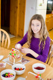 Decorating gingerbread houses Royalty Free Stock Photo