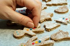 Decorating gingerbread man. And christmas cookies Stock Images