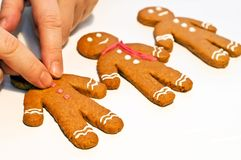 Decorating gingerbread man. Christmas cookies Royalty Free Stock Photography