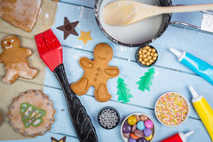 Decorating of gingerbread man Christmas cookie Royalty Free Stock Photo